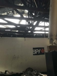 Shown here is the underside of the roof inside Racers Division after the fire. The heat caused a collapse of the roof and several support beams. Photo courtesy of John Cooper