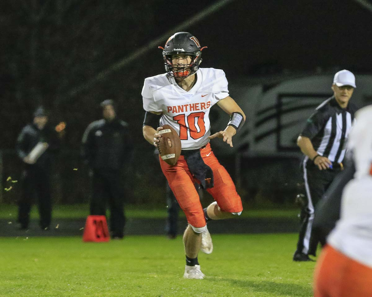 Washougal quarterback Dalton Payne, shown here earlier this season, helped Washougal to its first state playoff win since 1974. Photo by Mike Schultz