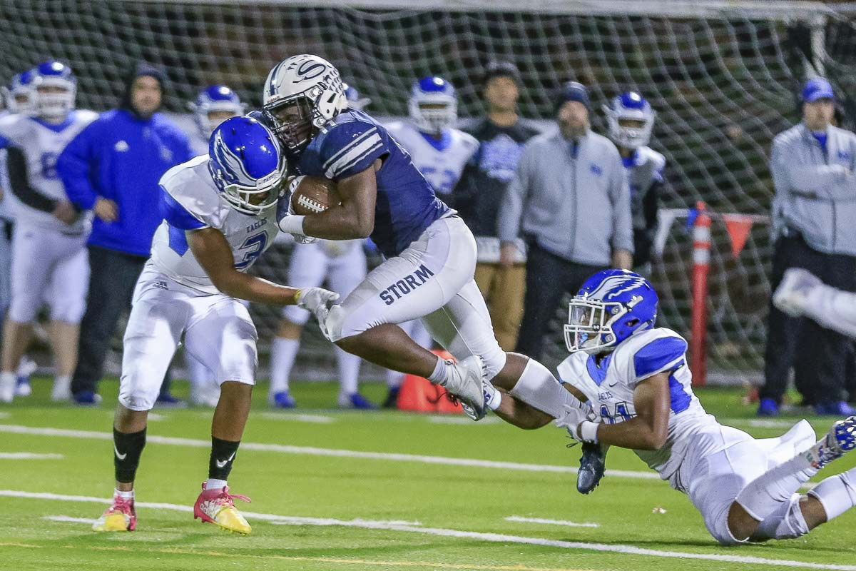 Skyview running back Jalynnee McGee (11) refused to be denied when he carried the football in Friday's Class 4A playoff game at Kiggins Bowl. McGee shredded the Federal Way defense en route to a 49-0 victory by the Storm. Photo by Mike Schultz
