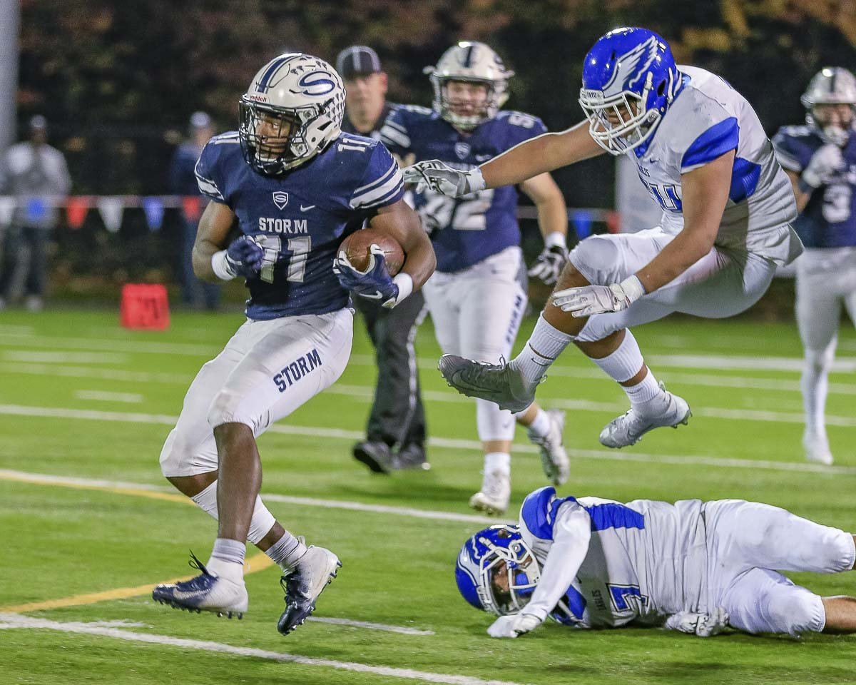 Skyview's Jalynnee McGee (11) finishes off one of his four touchdown runs in the first half of Friday's playoff victory over Federal Way. McGee finished with six touchdowns in the game as Skyview advanced in the Class 4A playoffs with a 49-0 win at Kiggins Bowl. Photo by Mike Schultz