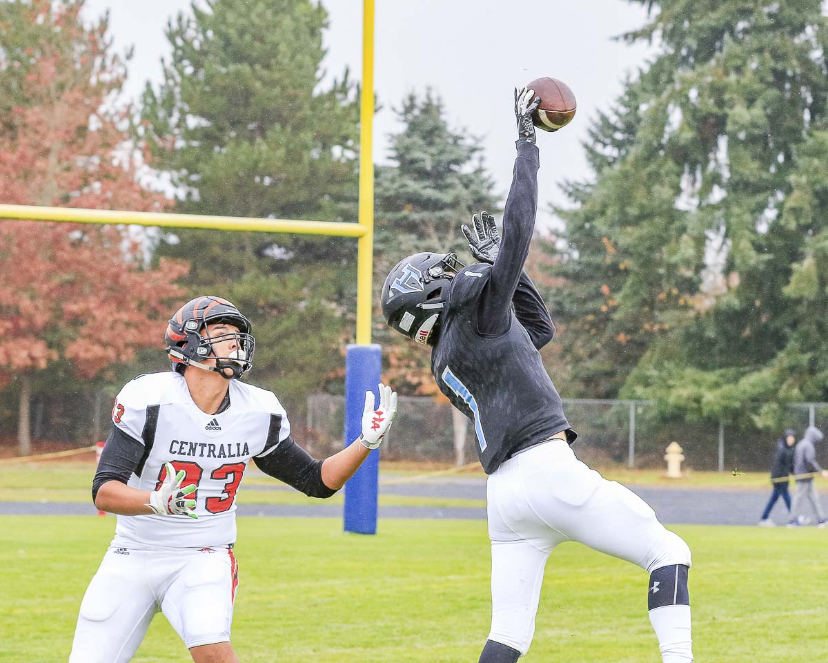 Hockinson's Andre Northrup (1) leaps high to knock down a pass intended for a Centralia receiver during the Hawks' playoff victory Saturday at Hockinson High School. Photo by Mike Schultz