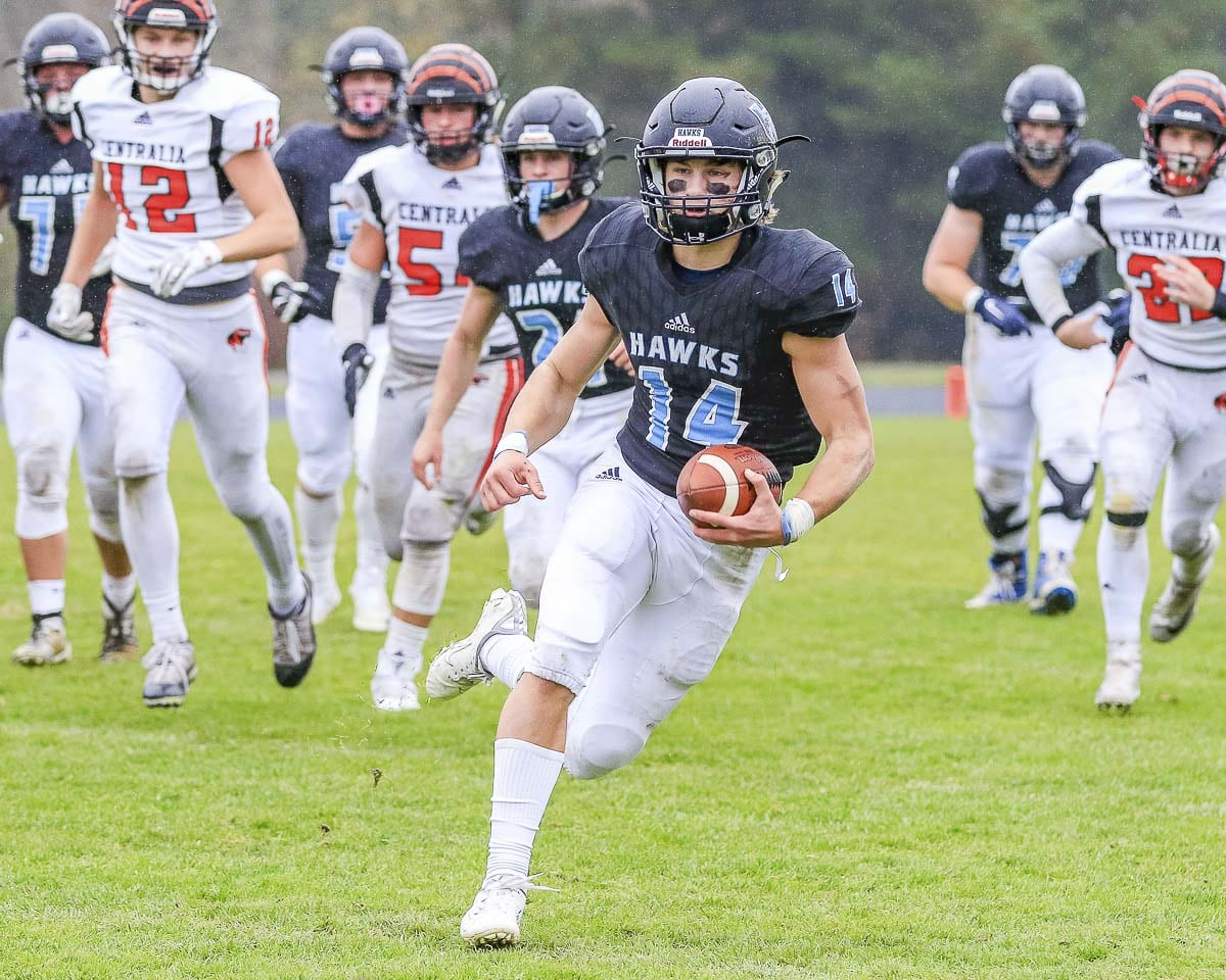Hockinson quarterback Levi Crum rushes for yardage during the Hawks' 59-7 victory over Centralia in the Class 2A football playoffs Saturday at Hockinson High School. Crum rushed for 110 yards and two touchdowns and also added a passing touchdown to lead Hockinson. Photo by Mike Schultz