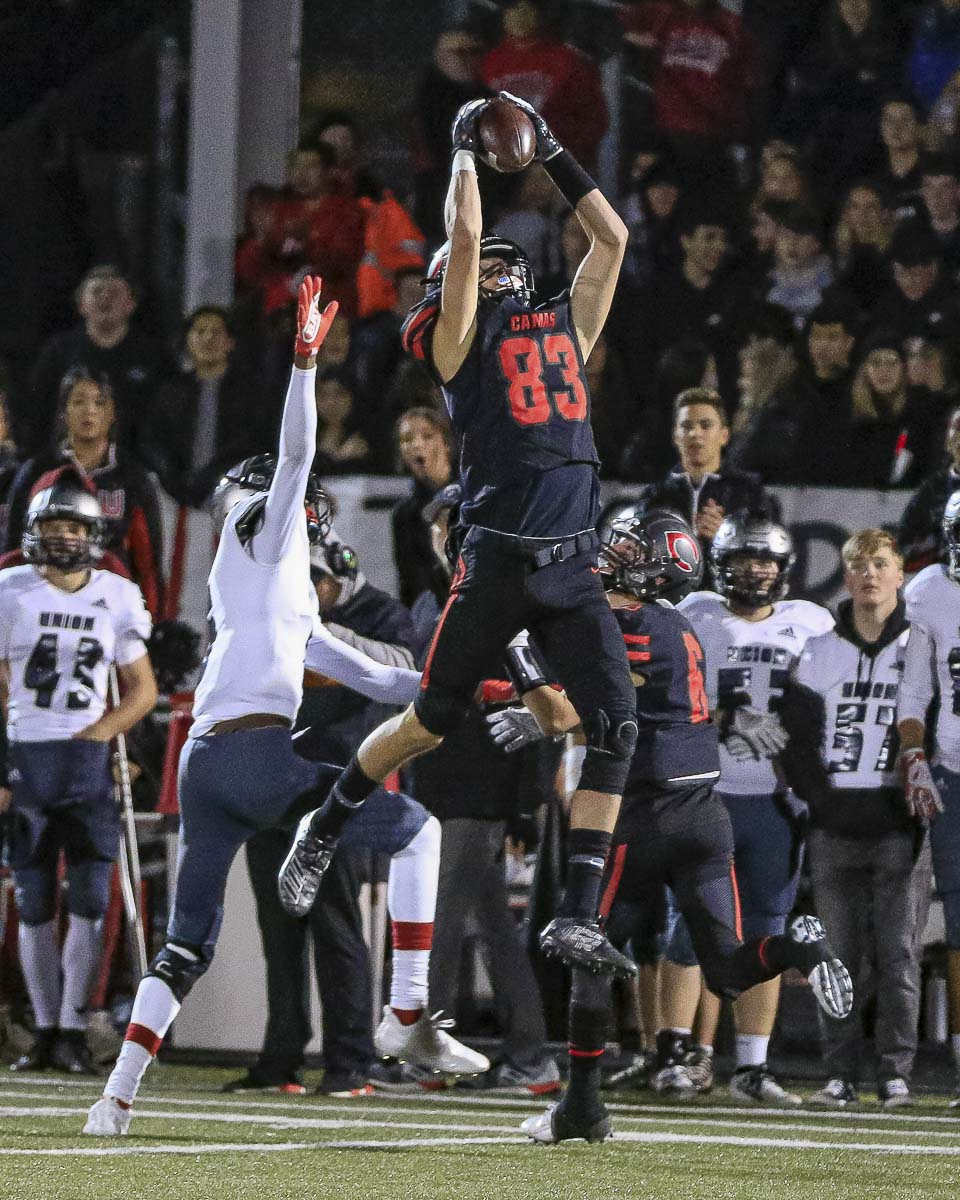 Camas' Jackson Clemmer also plays defense. Here he is going up high for an interception against Union. Photo by Mike Schultz