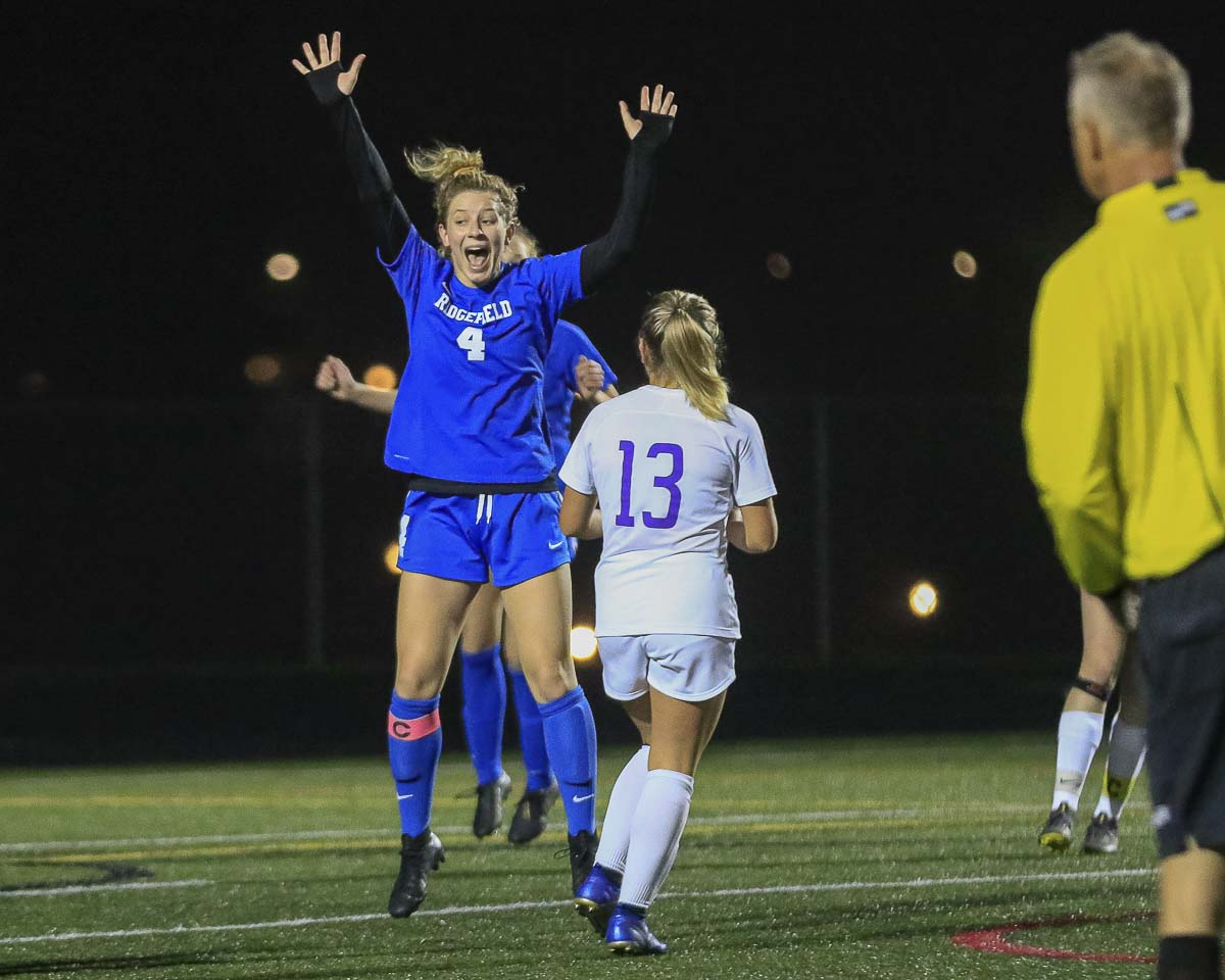 Brooke Weese celebrates her goal Tuesday night that gave Ridgefield a 3-0 lead over Sequim in the opening round of the Class 2A state girls soccer tournament. Photo by Mike Schultz