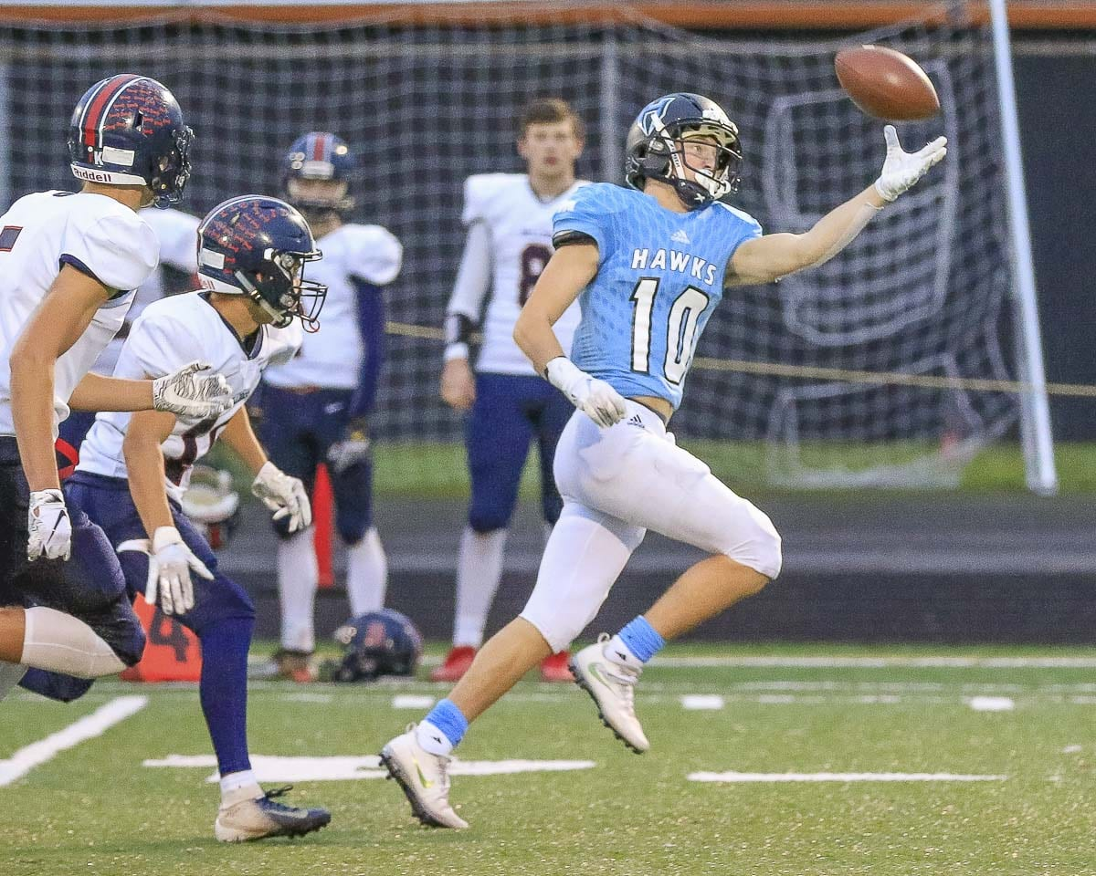 Hockinson receiver Liam Mallory (10) uses one hand to haul in a pass that turned into a touchdown in the second half of the Hawks' Saturday victory in a state playoff game played at Battle Ground's District Stadium. Photo by Mike Schultz