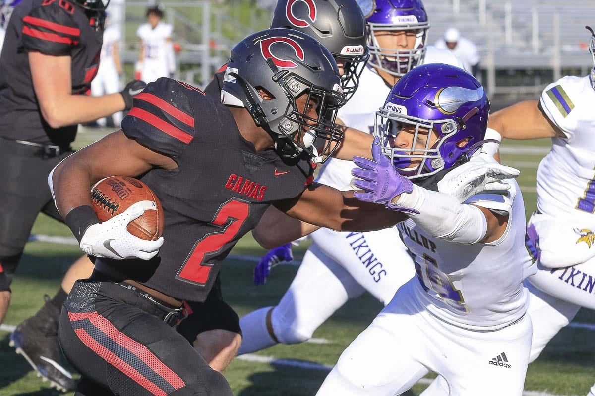 Camas running back Jacques Badolato-Birdsell (2) was one of many Papermakers with a standout performance (186 yards, two touchdowns) in Saturday's 56-27 win over Puyallup at Doc Harris Stadium. Camas advanced to the Class 4A state semifinals with the victory. Photo by Mike Schultz
