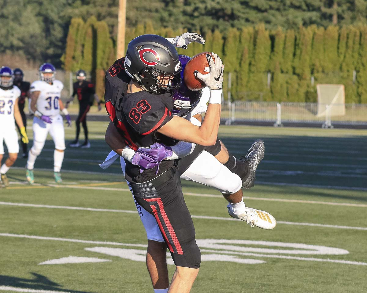 Camas receiver Jackson Clemmer (83) hauls in a pass during the Papermakers' 56-27 victory over Puyallup Saturday at Doc Harris Stadium. Clemmer caught six passes for 150 yards and two touchdowns in the game. Photo by Mike Schultz