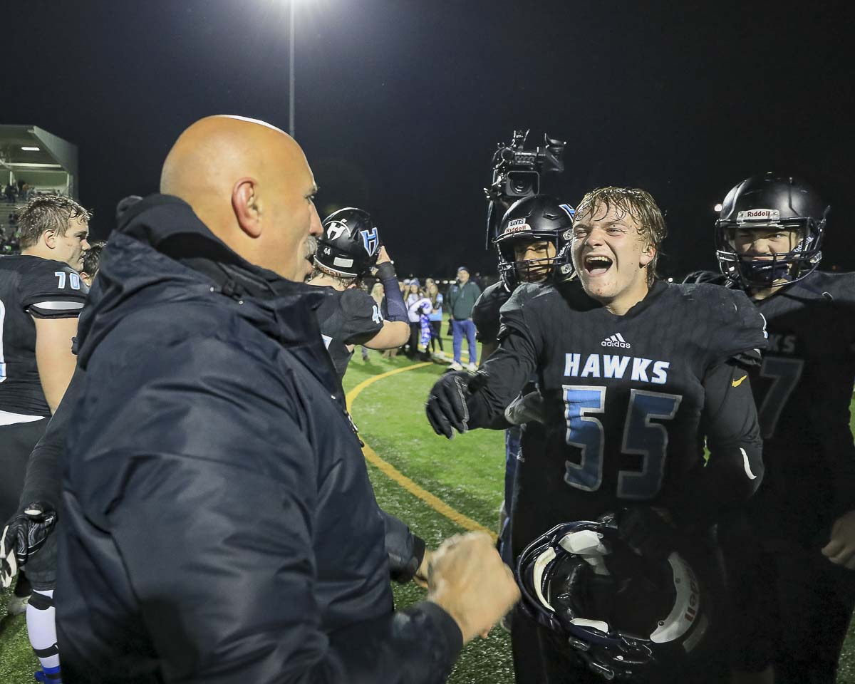 Hockinson coach Rick Steele (left) and Troy Visnius (55) enjoy a moment after the Hawks' come-from-behind 29-28 victory over Lakewood Saturday at District Stadium in Battle Ground. Photo by Mike Schultz