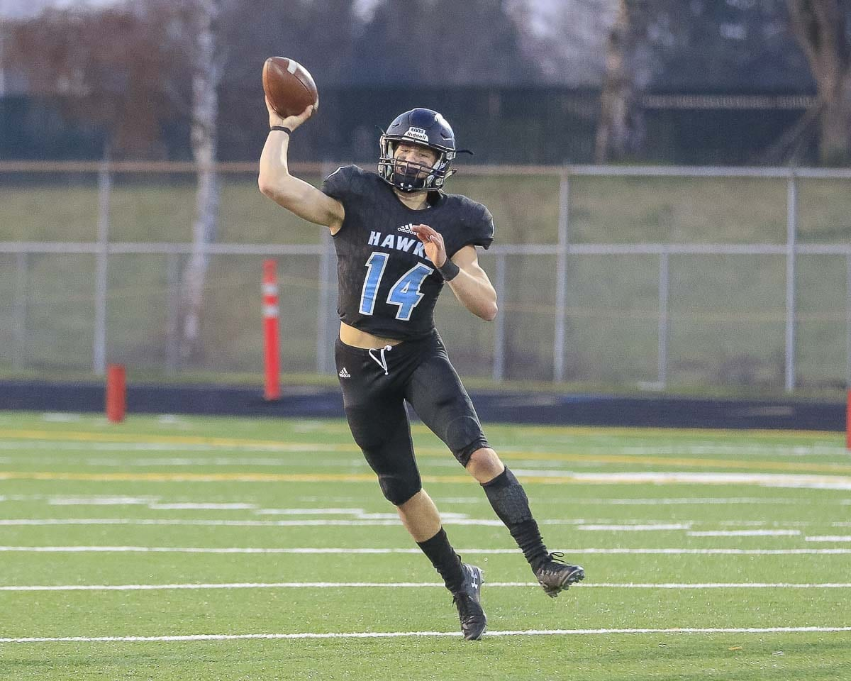 Hockinson quarterback Levi Crum, already a big name, has helped others get some recognition, too, just by spreading the ball around to different Hawks. Photo by Mike Schultz