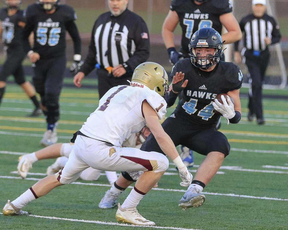 Hockinson running back Cody Wheeler (44) attempts to dart around a Lakewood defender during the Hawks' victory in the Class 2A state football playoffs Saturday at District Stadium in Battle Ground. Photo by Mike Schultz