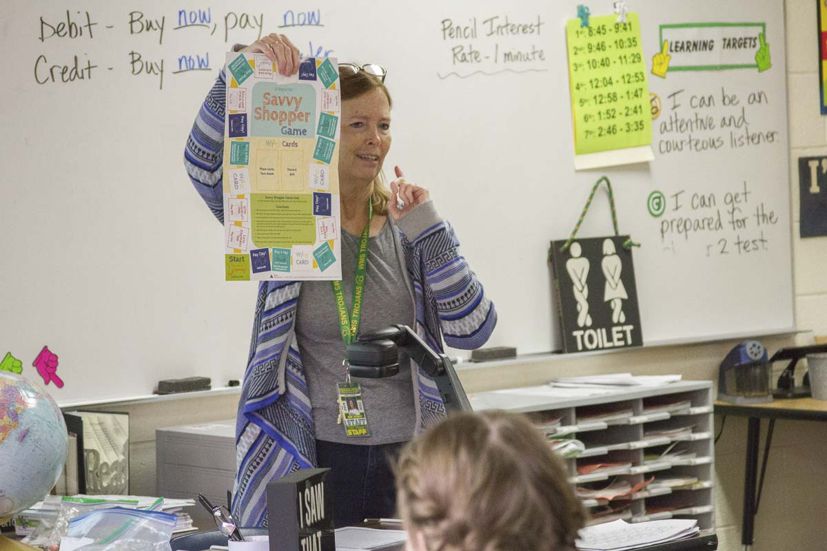 Robin Uhlenkott teaches financial literacy during Woodland Middle School's Personal Finance and Citizenship class started in 2018. Photo courtesy of Woodland Public Schools
