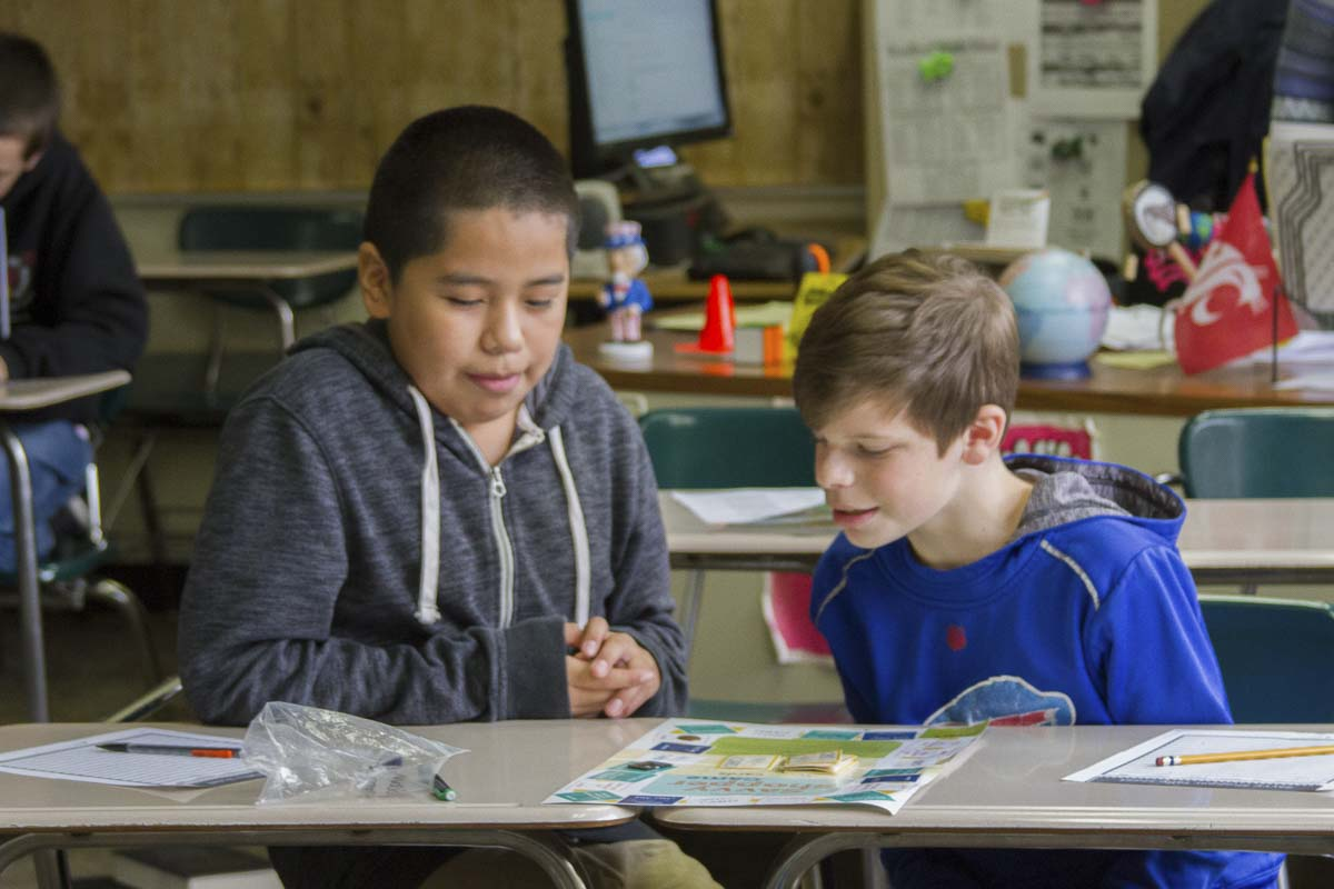"""'By learning about finance at a younger age, students will be better-prepared to manage their own finances when they graduate and begin their careers,' said Robin Uhlenkott, a teacher at Woodland Middle School. Photo courtesy of Woodland Public Schools"