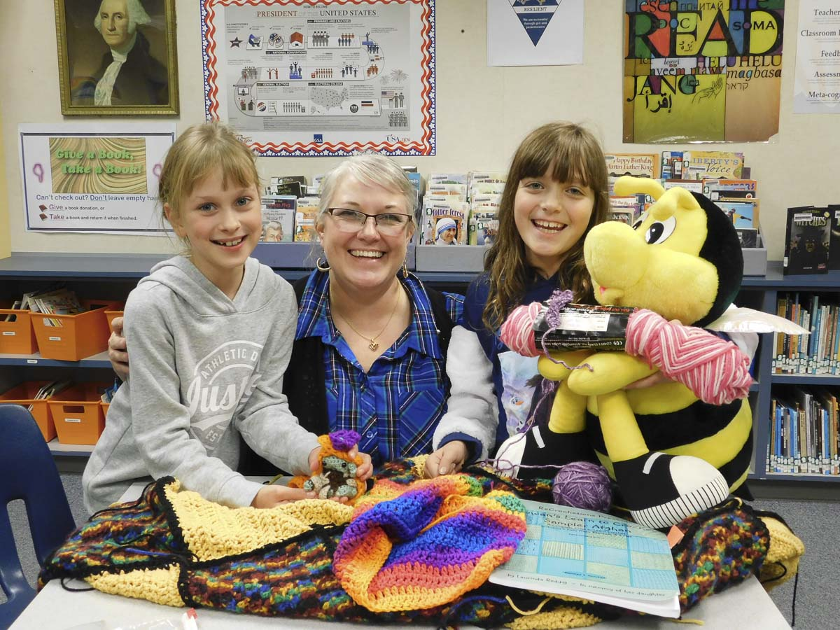 South Ridge Elementary School librarian, Emily Crawford, and third graders, Marta Krawczyk (left) and Liberty Glessing (right) show their Crochet Club projects. Photo courtesy of Ridgefield Public Schools