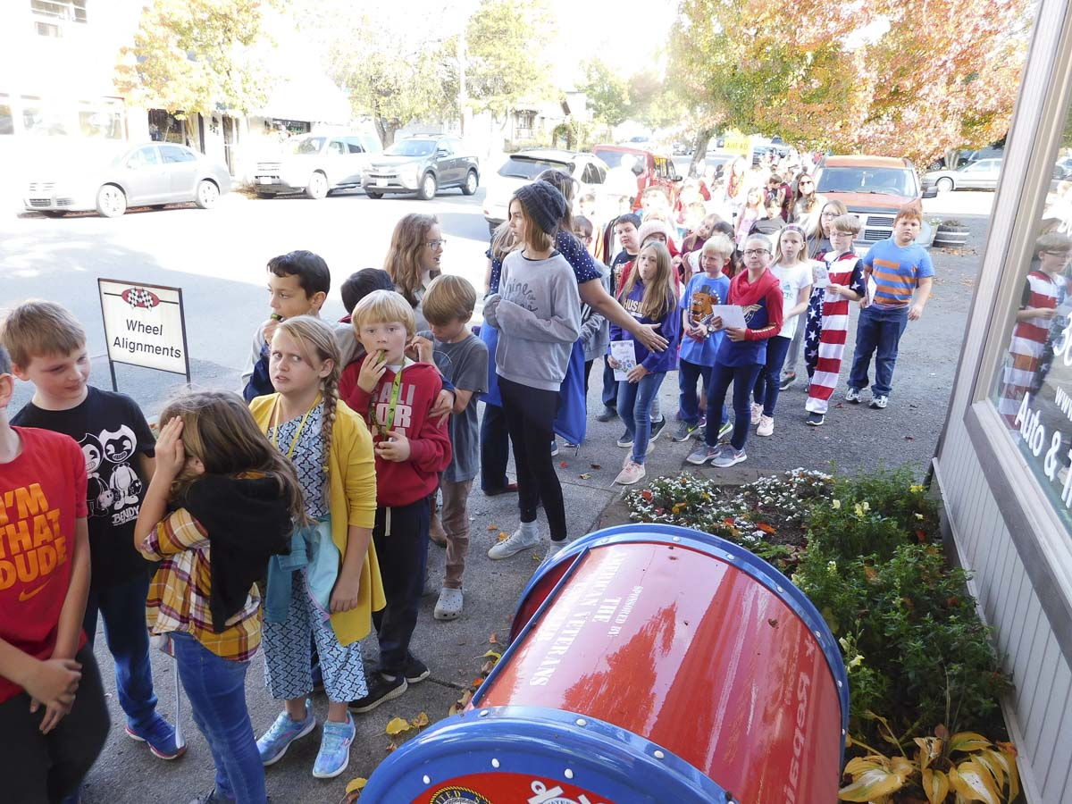 A long line of fourth graders from Union Ridge Elementary School wait to deposit their cards and letters for military service members into the special mailbox fronting Bob's Automotive. Photo courtesy of Ridgefield Public Schools