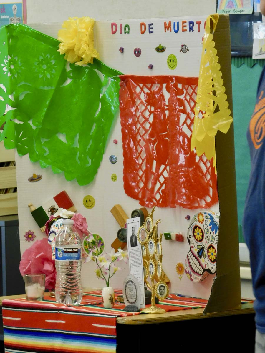 This display shows students the types of items that would be displayed on home altars or shrines during Dia de los Muertos to remember loved ones who have passed away. Photo courtesy of Ridgefield Public Schools