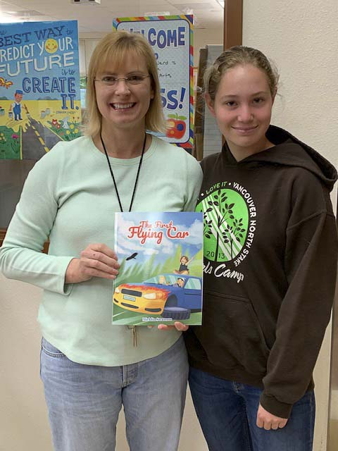 Michlin Swanson (right) with 8th grade teacher Melissa Theis (left). Photo courtesy of Battle Ground Public Schools