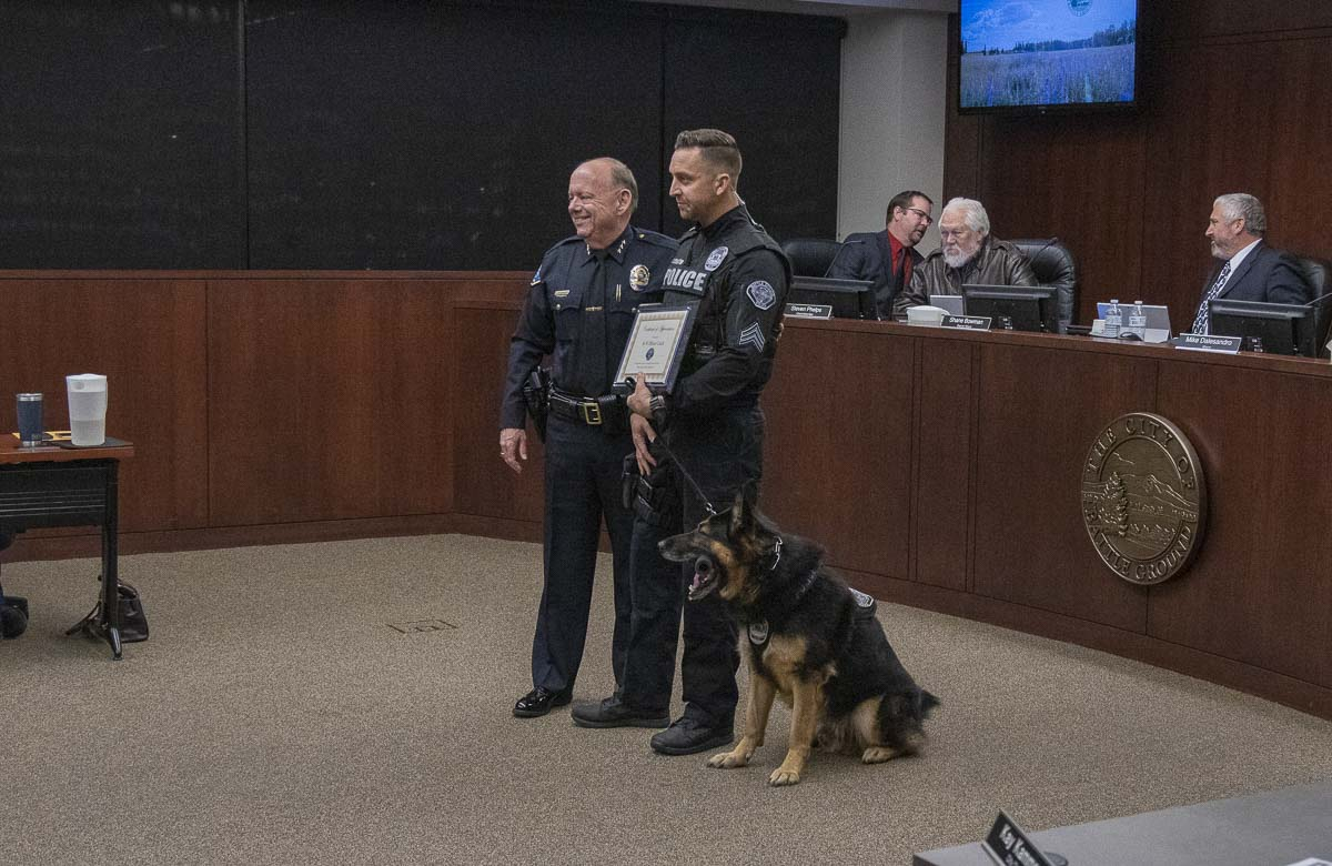 Battle Ground Police Chief Bob Richardson presents a plaque of recognition to K-9 Officer Luca and Sgt. Chris Crouch. Luca is retiring after six years with the force. Photo by Chris Brown