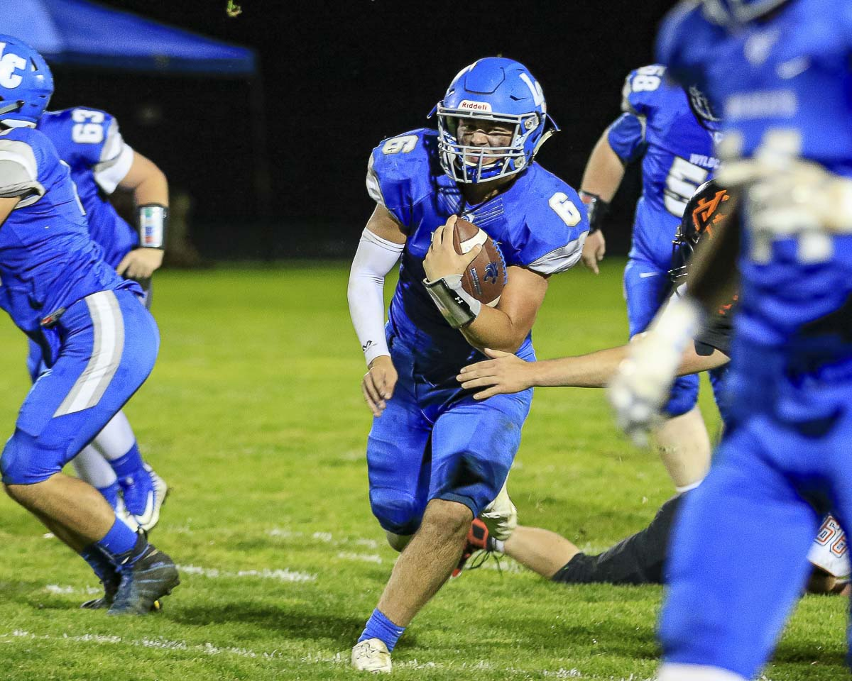 Quarterback Tom Lambert (6) is a key reason why the La Center Wildcats are undefeated this season. La Center won a wild game over Castle Rock Friday night, 42-39, to earn the Trico League championship and the Class 1A league's No. 1 seed into the playoffs. Photo by Mike Schultz