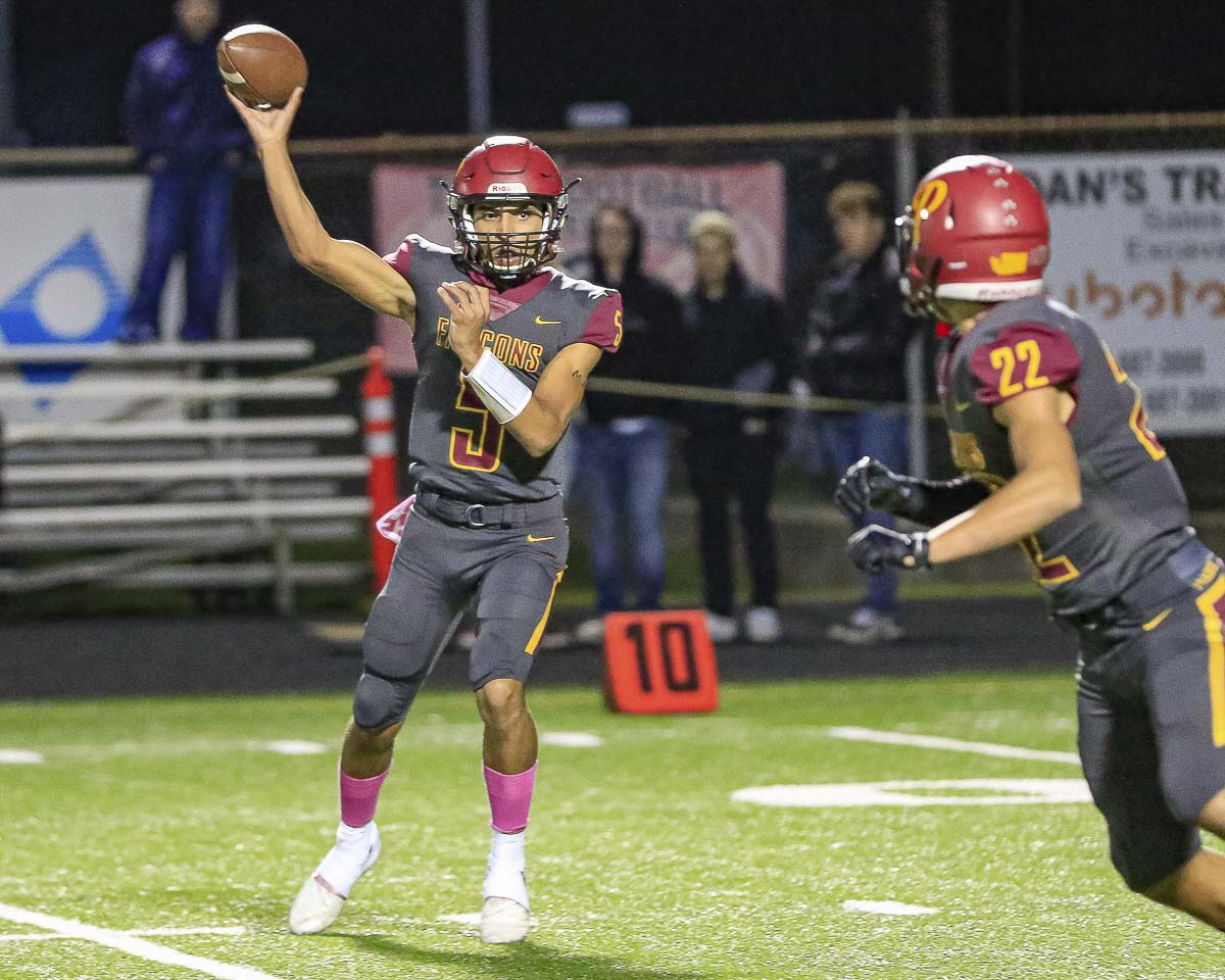 Prairie's A.J. Dixson, shown here earlier in the season, threw three touchdown passes Friday night. Marysville-Pilchuch, though, tied the game on the final play of regulation, then beat Prairie 37-30 in overtime in the opening round of the Class 3A state playoffs. Photo by Mike Schultz