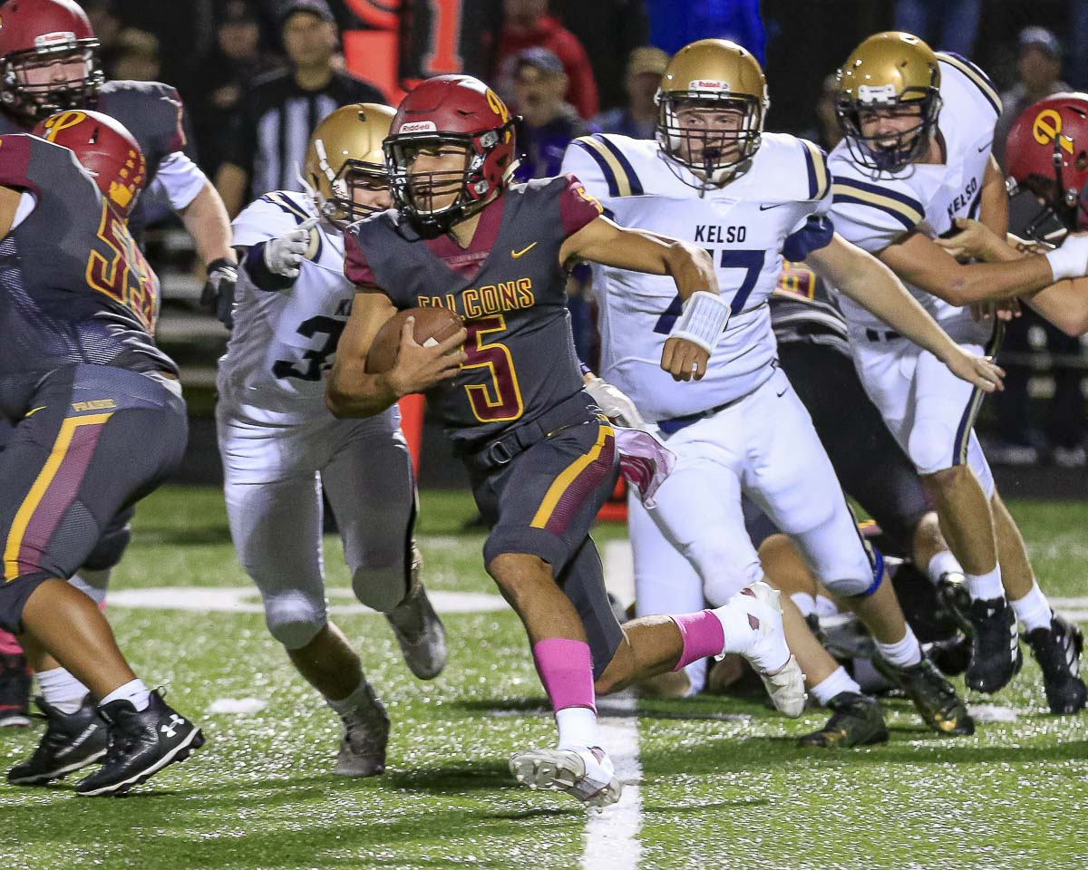 A.J. Dixson can use his legs or his arm to lead Prairie to points. The quarterback was named the 3A GSHL player of the year on offense and has led the Falcons to the state playoffs. Photo by Mike Schultz