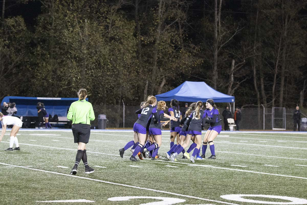 Yaneisy Rodriguez is mobbed by her Columbia River teammates after she scores what turns out to be the winning goal in the Class 2A girls soccer state championship game Saturday. Photo courtesy of Alan Moditz