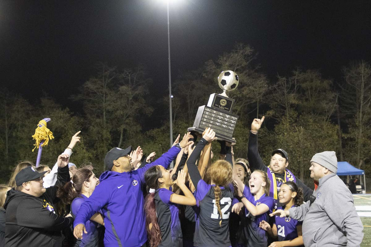 Members of the Columbia River girls soccer team celebrate after being presented with the state championship trophy Saturday. The Chieftains defeated Hockinson 1-0 in the championship game. Photo courtesy of Alan Moditz