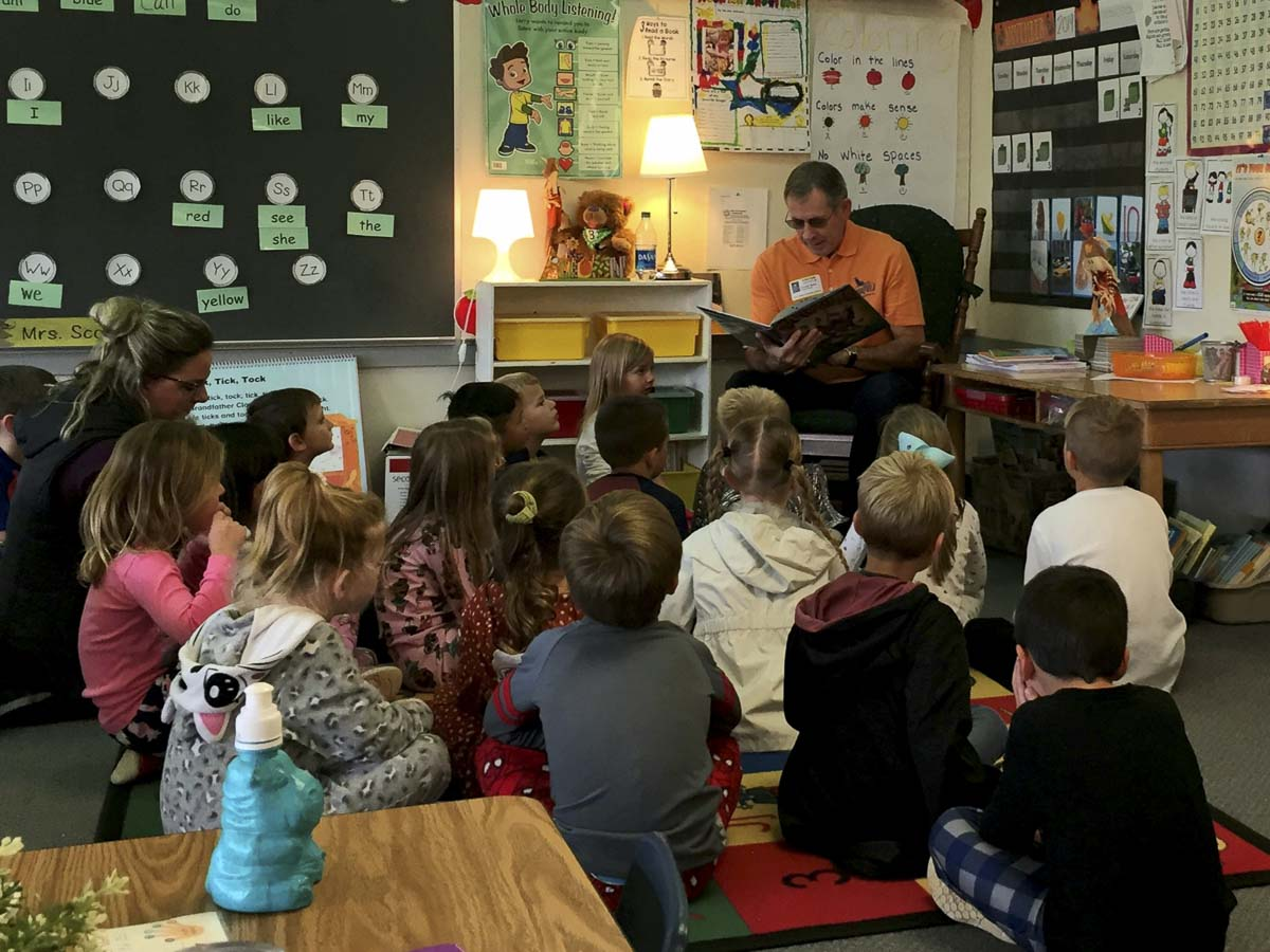 Ridgefield Mayor Don Stose reads to Union Ridge Elementary school students during a fun reading day celebrating the success of the school's Read-a-Thon fundraiser. Photo courtesy of Ridgefield Public Schools