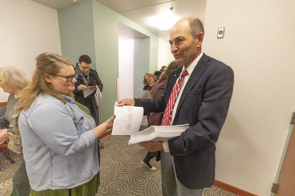 Clark County Auditor Greg Kimsey hands results from the Nov. 5 general election to Terah Pitchford Tuesday night. Photo by Mike Schultz