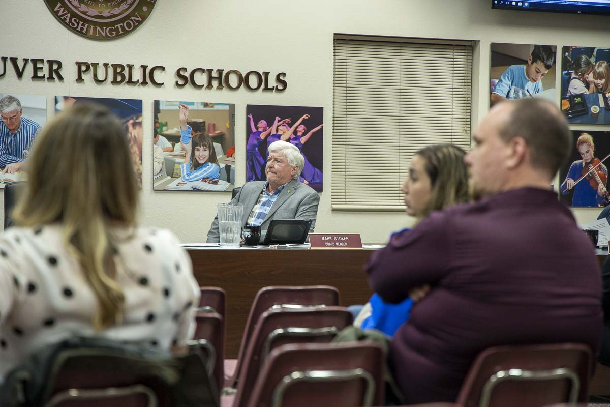 Vancouver Public Schools Board of Directors President Mark Stoker listens to a presentation during Monday's board meeting. Photo by Chris Brown