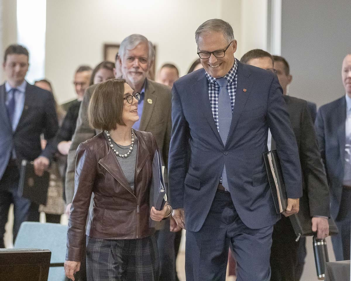 Oregon Governor Kate Brown and Washington Governor Jay Inslee walk into a press event at the Vancouver Waterfront to sign a Memorandum of Intent to build a new Interstate Bridge along I-5. Photo by Mike Schultz