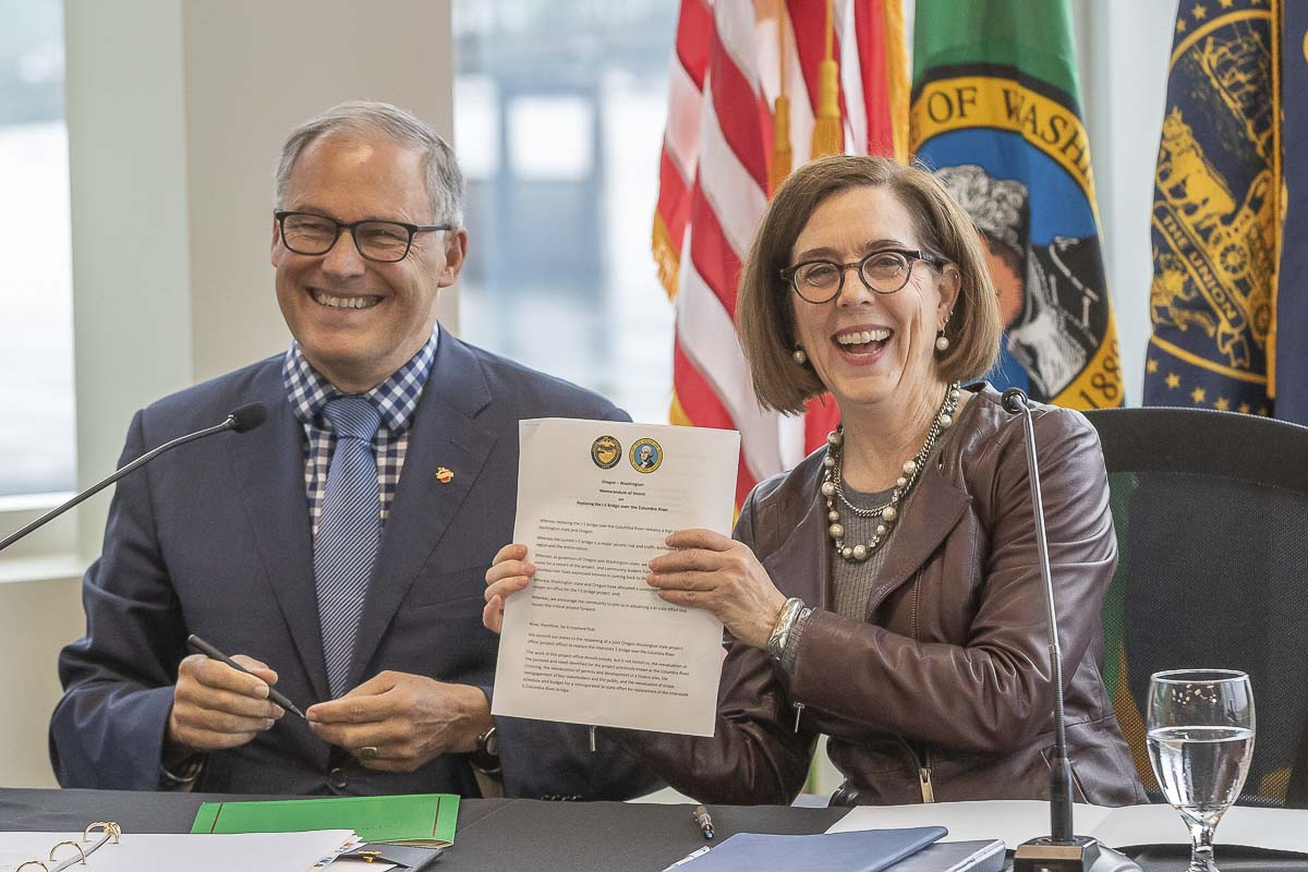 Washington Governor Jay Inslee and Oregon Governor Kate Brown signed a Memorandum of Intent on Monday to build a new Interstate Bridge along I-5. Photo by Mike Schultz
