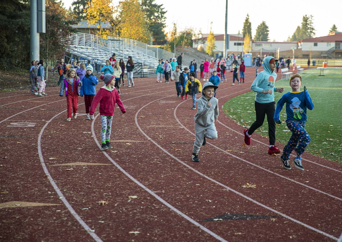 Third grade boys, including Max Rizhkov (center) and Benjamin Mullins (right), run the Morning Mile at King's Way Christian School's outdoor track. Photo by Jacob Granneman