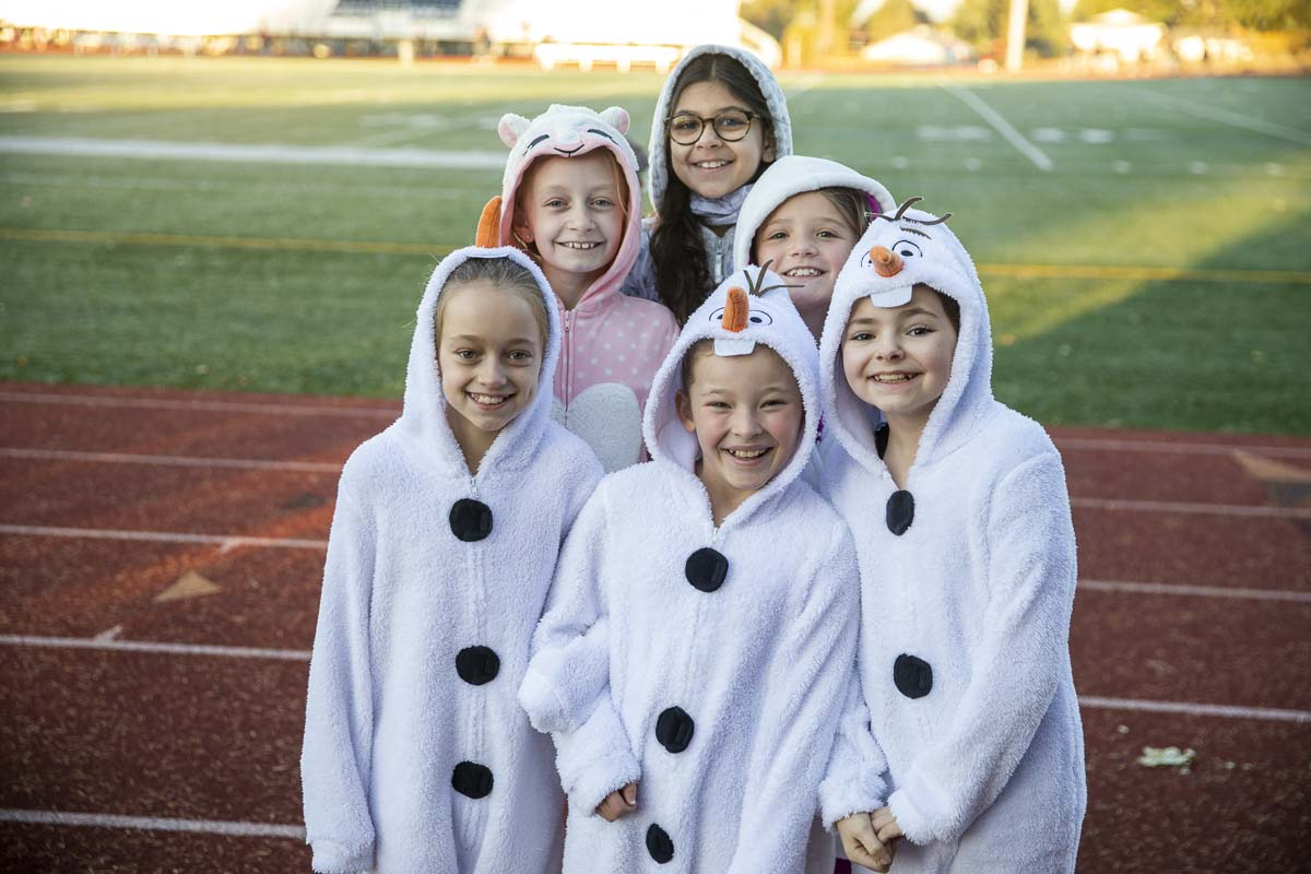 Fourth grade girls at King's Way Christian Elementary School wear their pajamas for Pajama Day during the Morning Mile on the track. Shown here (front from left to right) Chloe Hill, Genesis Porter, Maddie Lemmon; (middle) Kaylie Doing, Emma Haas; (back) Ellie Simmons. Photo by Jacob Granneman