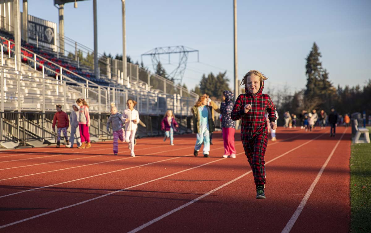 Maddie Jackson, a kindergartener at King's Way is seen here running the Morning Mile as part of the school's Purposeful Play program. Photo by Jacob Granneman