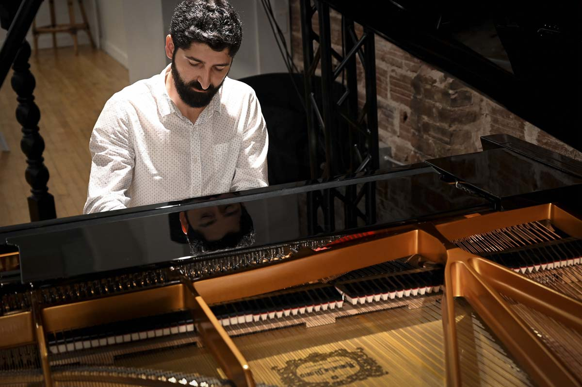 Dimitri Zhgenti performs solo piano at Tandem Hall as part of the opening concert for his classical concert series, Musica Lanterna. Photo courtesy of Heather Finch