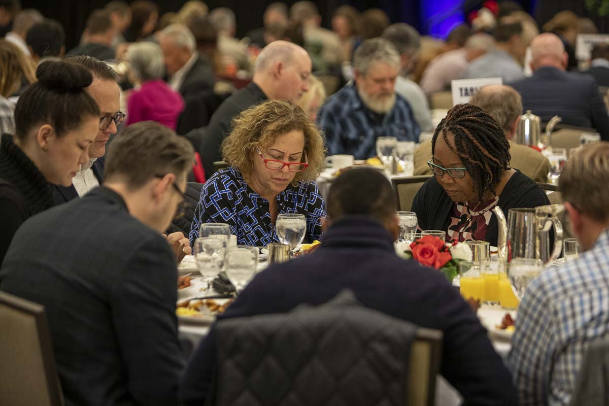Community members join in corporate prayer for different topics, including first responders and healthcare professionals in Clark County, during the 2019 Clark County Prayer Breakfast. Photo by Jacob Granneman