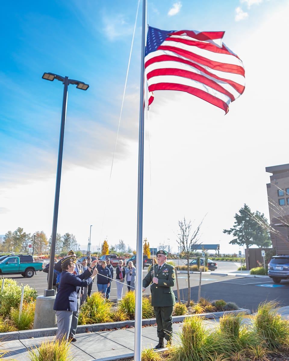 The newly dedicated flag pole at The Black Pearl on the Columbia is hoisted to full mast on Veterans Day 2019. Photo by Mike Schultz