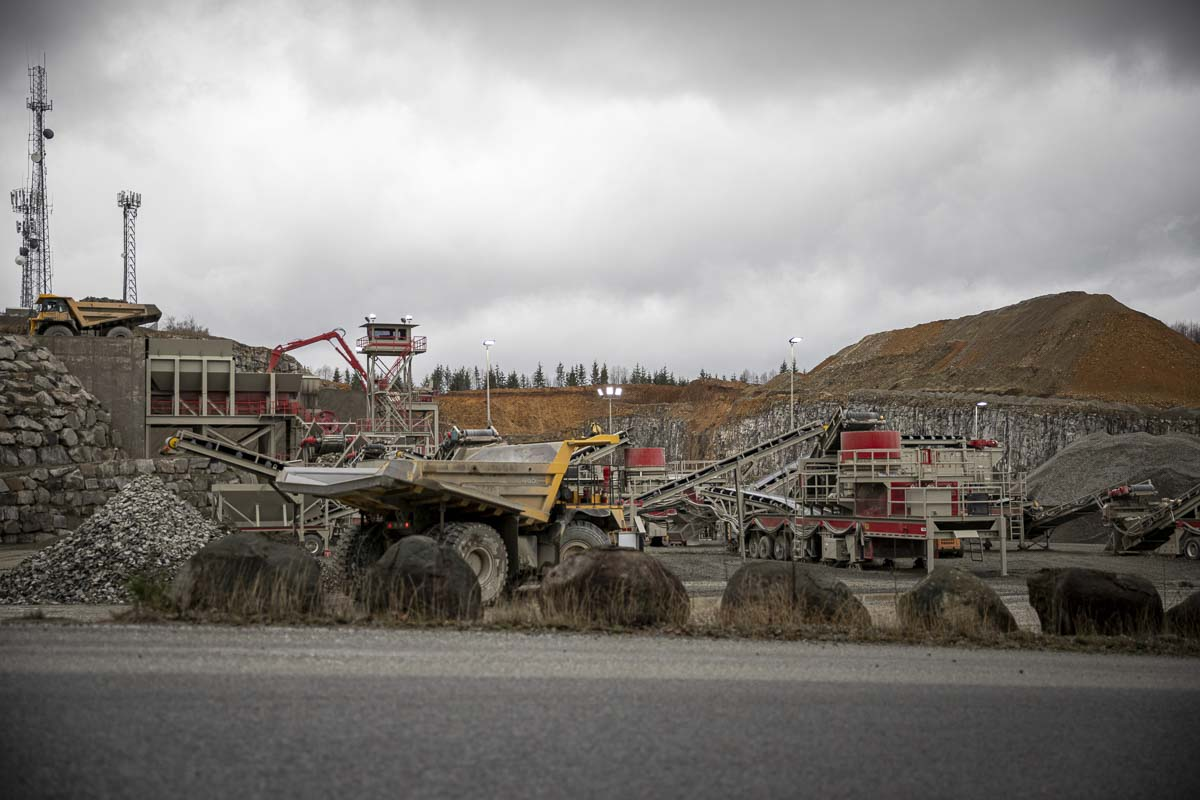 Yacolt Mountain Quarry's crusher operation is seen here with multiple trucks in the foreground transporting aggregate to and from the site. Photo by Jacob Granneman