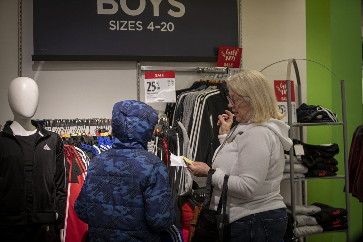 Tracy Pate helps her paired child, Evan find new shirts during the 2019 Santa Clothes event at the Vancouver Mall. Photo by Jacob Granneman