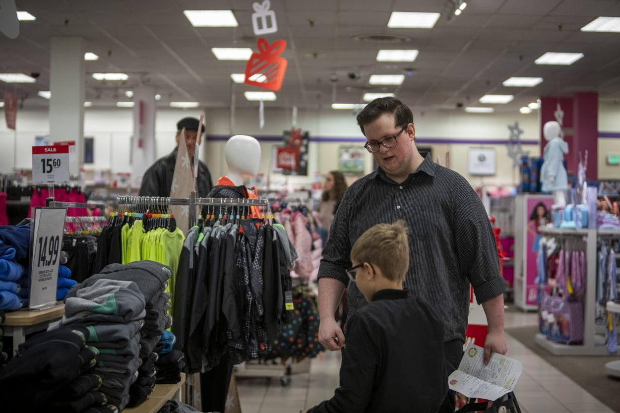 Nathan Campbell helps his new friend Jaxon Melton find new clothes on his list during Santa Clothes at JC Penny. Photo by Jacob Granneman