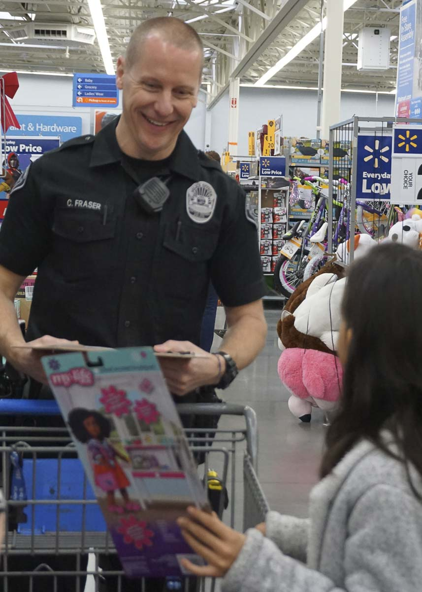 Battle Ground Police Officer Clint Fraser shops with children. Photo courtesy of city of Battle Ground