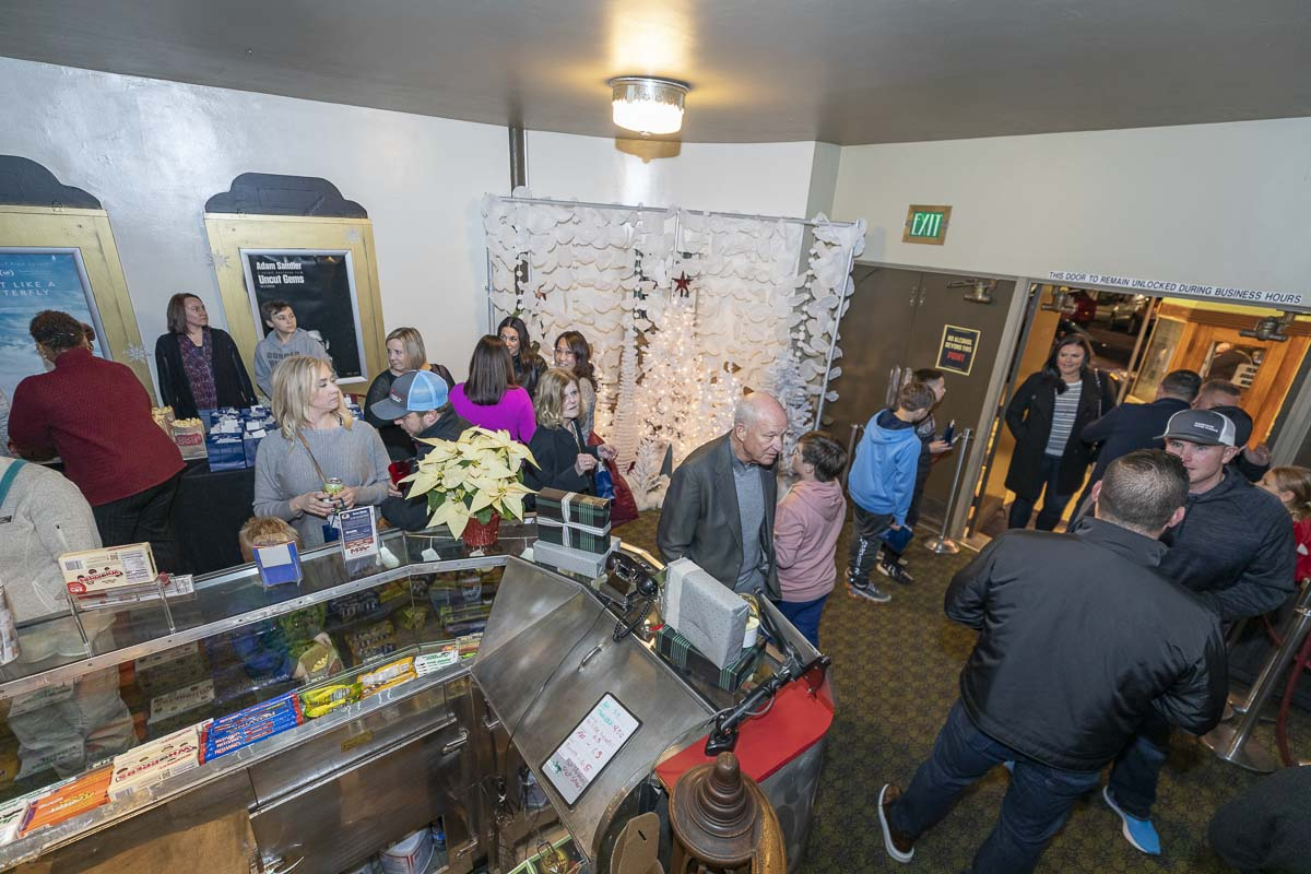 "Attendees of the Cano Real Estate Customer Appreciation Night enjoyed a fully hosted evening that included plenty of food, movie snacks, drinks and refreshments before the playing of the holiday movie favorite ""A Christmas Story.'' Photo by Mike Schultz"
