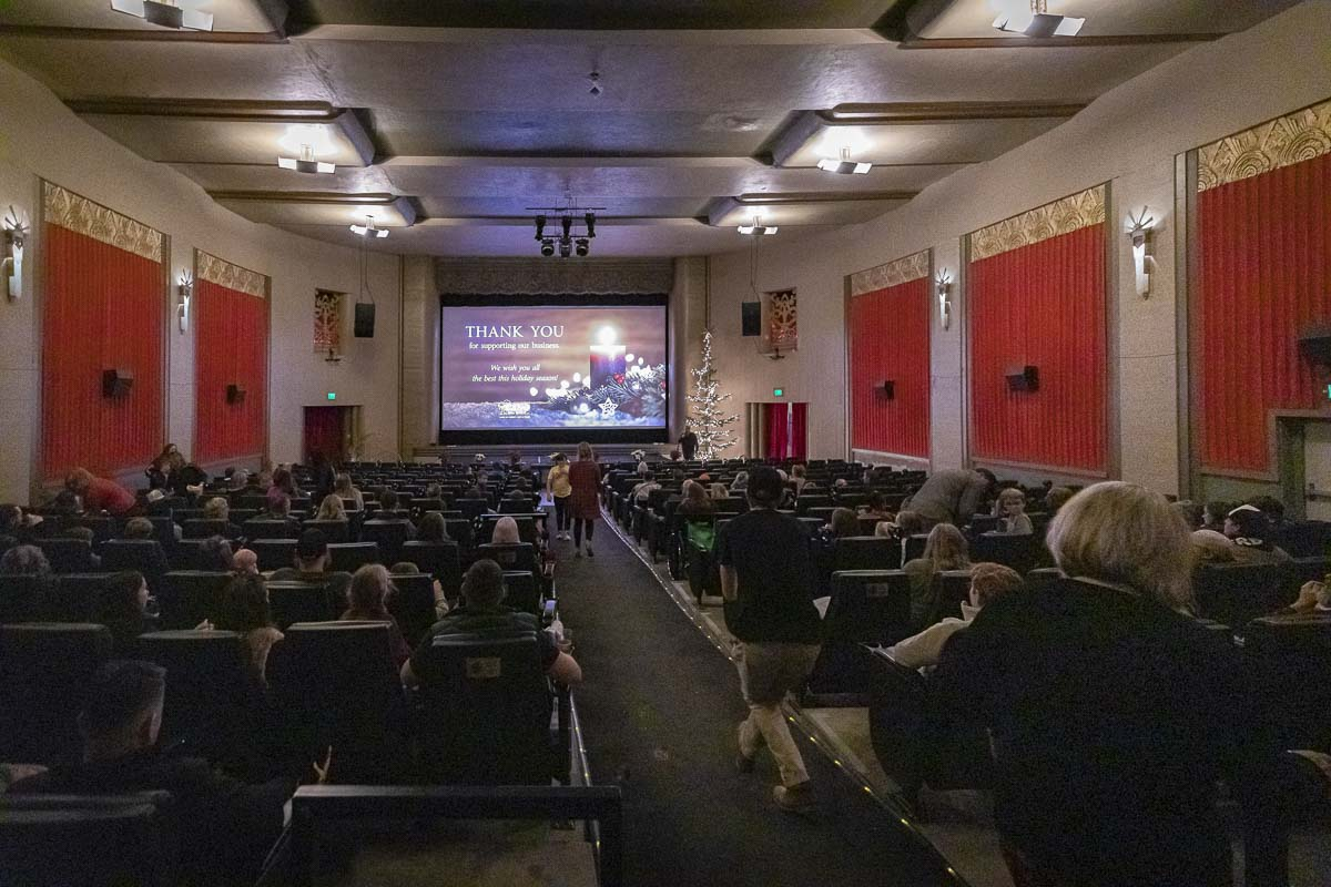 Clients who purchased or sold a home, or those who referred a client for a transaction that closed in 2019, flocked to Kiggins Theatre this week for the Cano Real Estate Customer Appreciation night. Photo by Mike Schultz