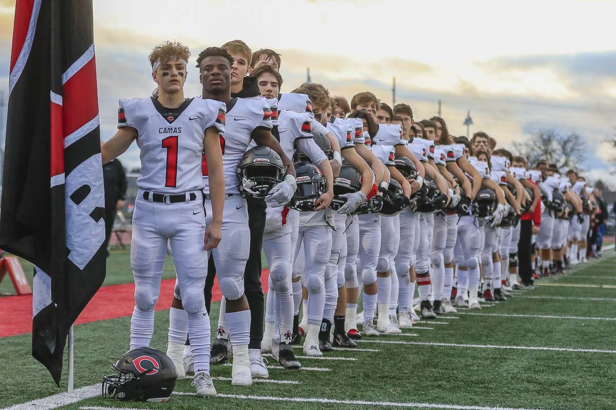 The Camas Papermakers lineup for the National Anthem prior to Saturday's Class 4A state championship game. Photo by Mike Schultz