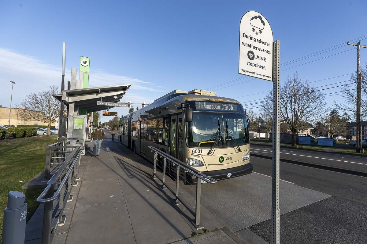 A lone commuter is shown here at a platform along The Vine, C-TRAN's bus rapid transit system along NE Fourth Plain Blvd. in Vancouver. Photo by Mike Schultz