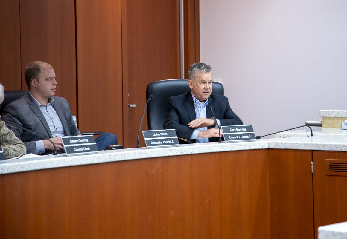 District 4 Clark County Councilor Gary Medvigy speaks during a budget hearing, as District 3 Councilor John Blom watches on. Photo by Chris Brown