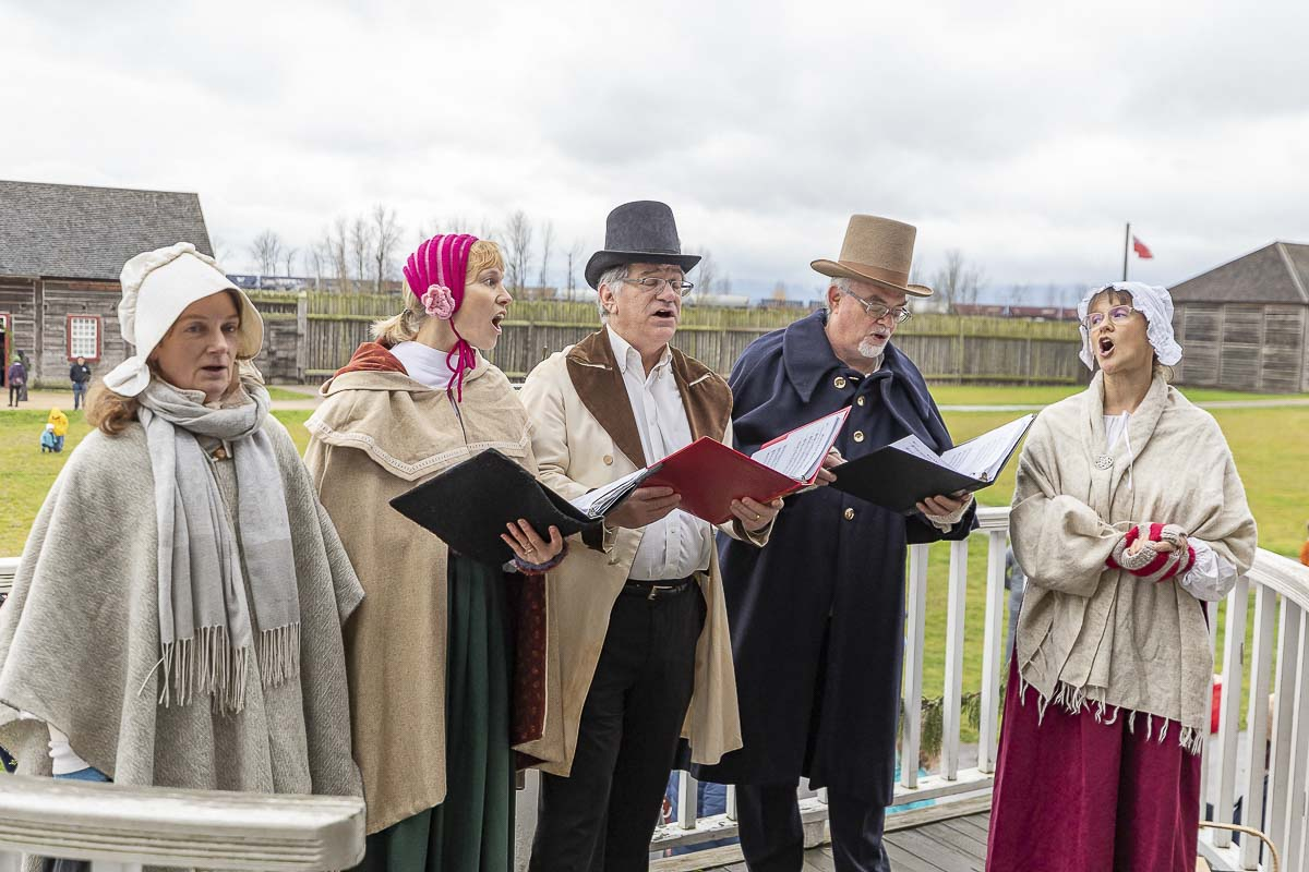 Carolers provide entertainment to visitors of the Christmas at Fort Vancouver event Saturday. Photo by Mike Schultz