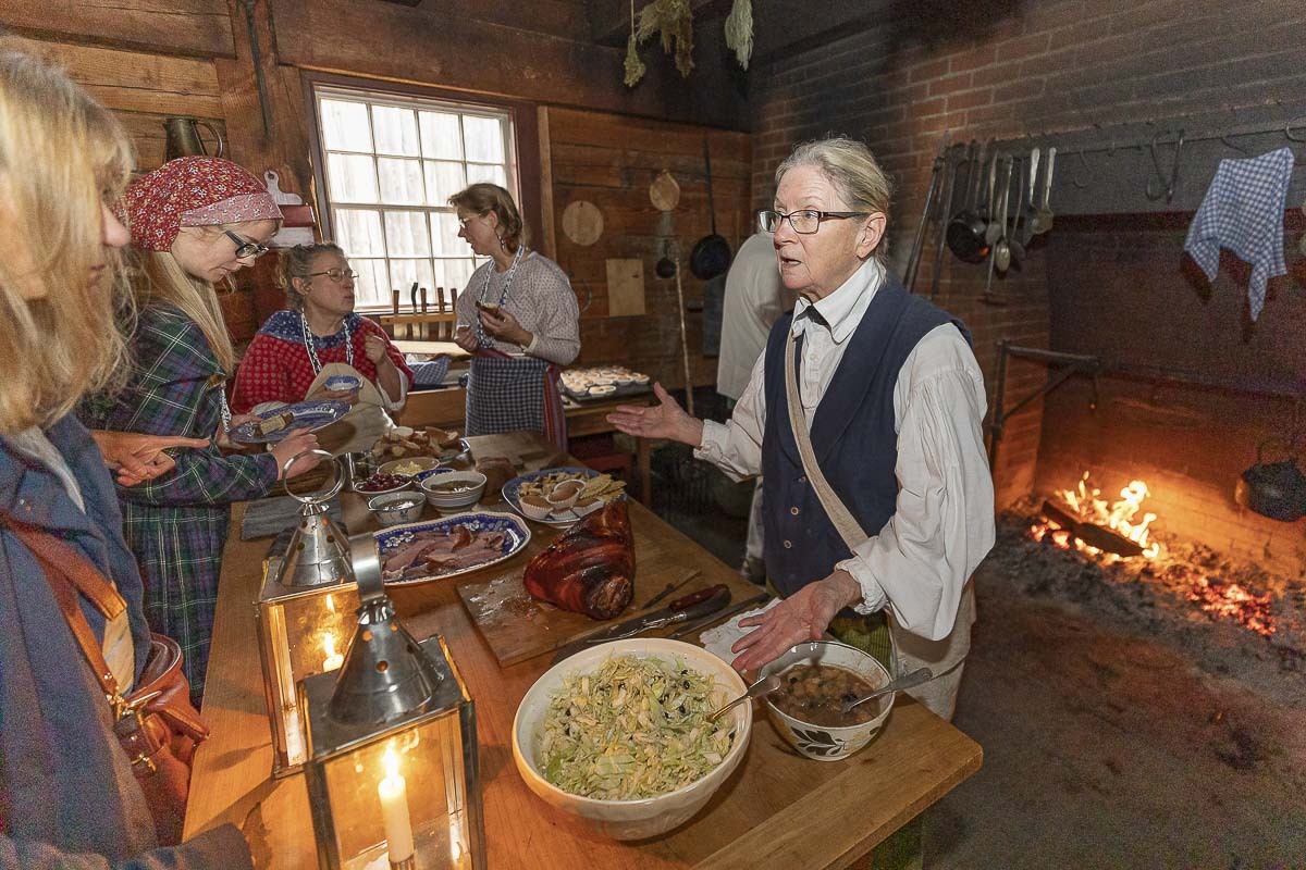 Volunteer Nancy Funk serves meals to volunteers in the kitchen at Saturday's Christmas at Fort Vancouver event. Photo by Mike Schultz