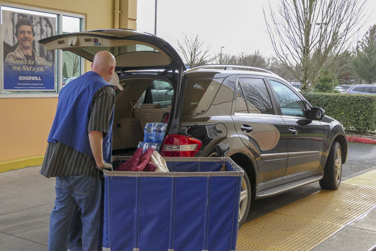 A vehicle drops off items at the Goodwill store on 162nd Avenue in east Vancouver in Dec. 2018. File photo by Chris Brown