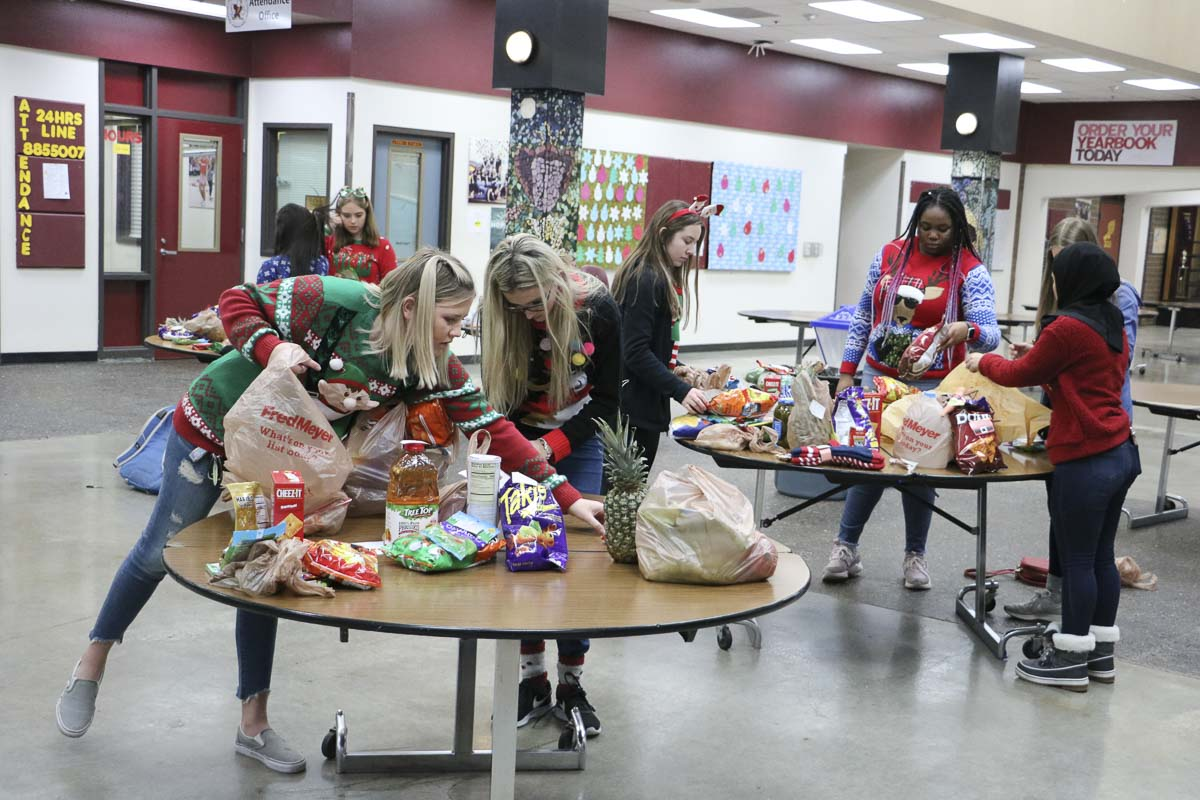 Students sort items for its Winter Wishes week of giving. Photo courtesy of Battle Ground Public Schools